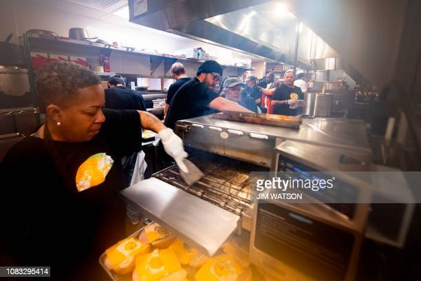 Volunteers prepare a free meal for furloughed federal workers at Andres in Washington DC on January 16 as the restaurant reached out to locals...
