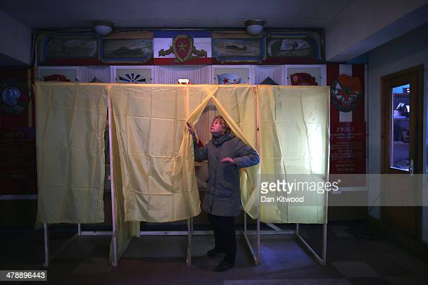Volunteers prepare a polling station in Simferopol on March 15 2014 in Simferopol Ukraine As the standoff between the Russian military and Ukrainian...