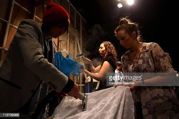 Volunteers prepare backstage ahead of the Limedrop show during Rosemount Australian Fashion Week Spring/Summer 2011/12 at Overseas Passenger Terminal...