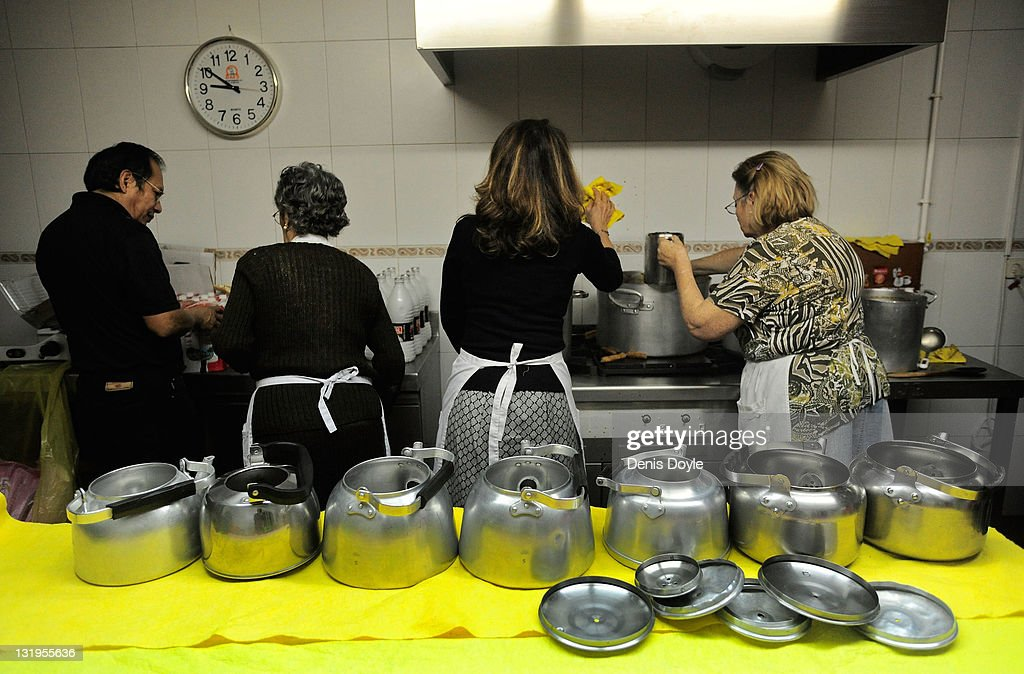 Volunteers prepare breakfast for poor and homeless people at the Ave Maria charity food centre on November 9, 2011 in Madrid, Spain. Poor people and homeless are given a free breakfast at the centre run by the Fundacion Real Congregacion de Esclavos del Dulce Nombre de Maria. Spain goes to the polls on November 20, 2011, while facing economic stagnation and the highest unemployment rate in Europe.