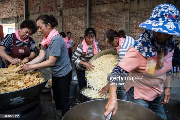 Volunteers prepare food for pilgrims on day three of the nine day Mazu pilgrimage on April 15 2018 in Xizhou Taiwan The annual Mazu Pilgrimage begins...