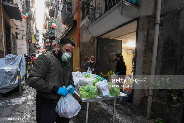 Volunteers prepare packages of basic necessities with primary products for poor people in the popular neighborhoods of Naples city Organized by the...