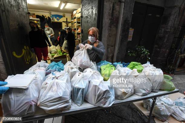 Volunteers prepare packages of basic necessities with primary products for the poor people in the popular neighborhoods of Naples city Organized by...