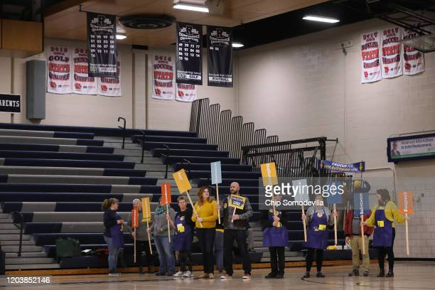 Volunteers prepare the area inside the Roosevelt High School gymnasium where supporters of Democratic presidential candidate former South Bend...