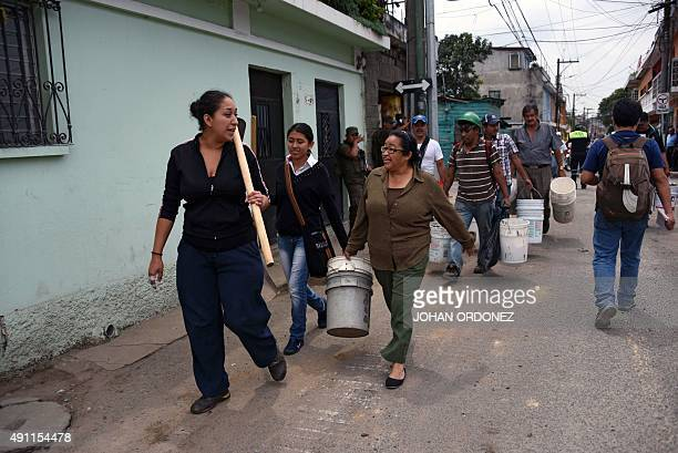 Volunteers prepare to help in the rescue works after Thursday's landslide in Santa Catarina Pinula municipality some 15 km east of Guatemala City on...