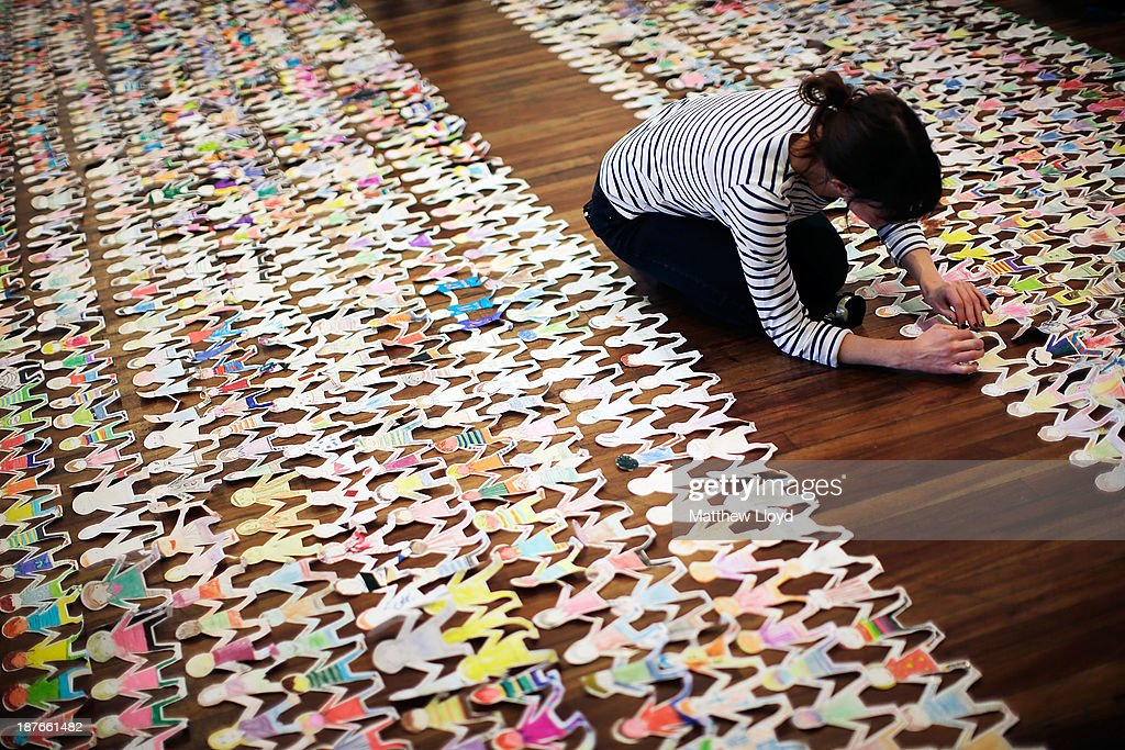 Volunteers put the finishing touches to a world record attempt at the longest chain of paper dolls ever at the Royal Festival Hall on November 11, 2013 in London, England. The event was organised to coincide with the launch of a book called The Paper Dolls, written by acclaimed author Julia Donaldson, and involved 45,000 dolls being submitted from as far apart as Brazil and Hong Kong.
