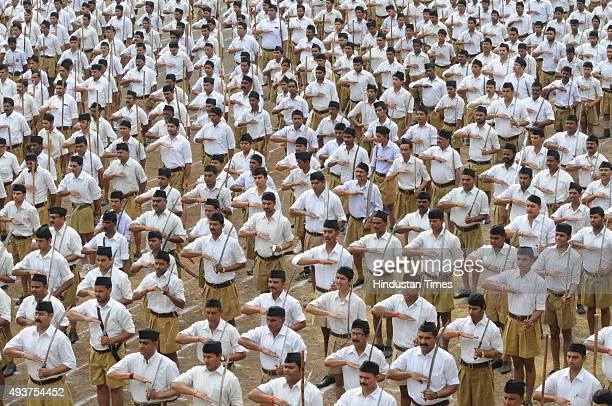 RSS volunteers queue up Dussehra Path Sanchalan at Jehangirabad area on October 22 2015 in Bhopal India The rightwing nationalist organization RSS...