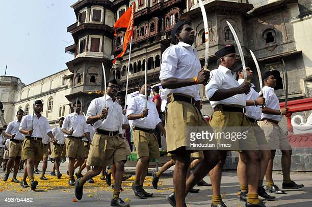 RSS volunteers queue up for Dussehra Path Sanchalan at Jehangirabad area on October 22 2015 in Indore India The rightwing nationalist organization...