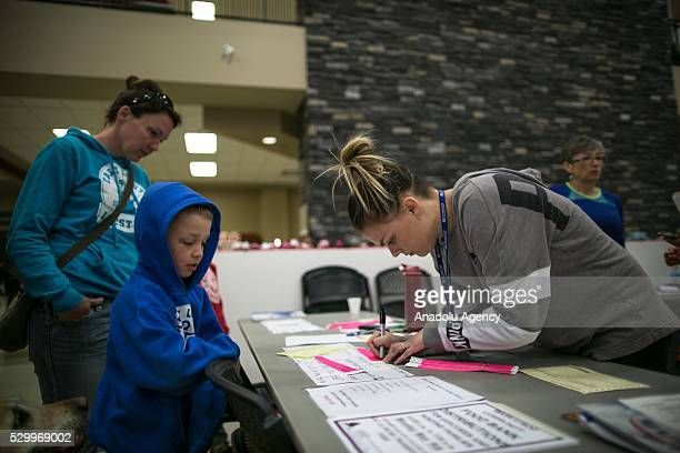 ALBERTA CANADA MAY 9 2016 Volunteers register evacuees in Bold community center in Lac la Biche south of Fort McMurray Alberta Canada on 9 May 2016...