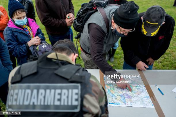 Volunteers register with the French gendarmes to take part in the searches in the woods of Milhars, on December 23 to look for Delphine Jubillar, a...