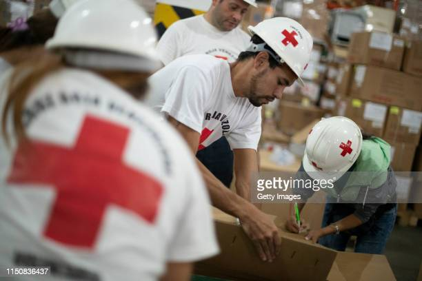 Volunteers repack medicines in a warehouse of International Committee of the Red Cross on June 19 2019 in Caracas Venezuela A second shipment arrived...