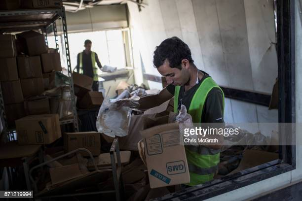 Volunteers search for useful medical items inside the destroyed Salam Hospital on November 5 2017 in Mosul Iraq Salam Hospital Mosul's main hosptal...