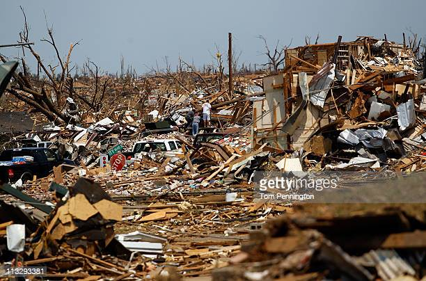 Volunteers search through destroyed homes on April 30, 2011 in Tuscaloosa, Alabama. Alabama, the hardest-hit of six states, is reported to have had...