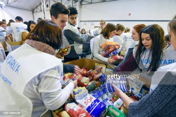Volunteers seen sorting food from Food Banks in different provinces at a central warehouse of Barcelona Catalonia Spain The food was sorted by type...