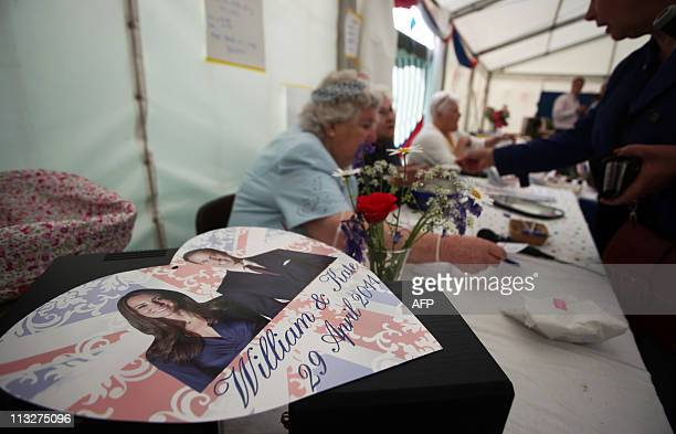 Volunteers sell raffle tickets at a Tea in the Park event in in Kate Middleton's home village of Bucklebury on April 29 2011 AFP PHOTO / CHRIS...