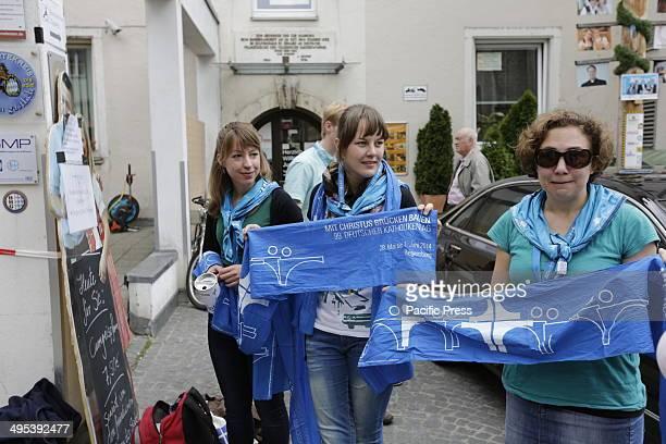 REGENSBURG BAVARIA GERMANY Volunteers sell the traditional Katholikentag scarf at the 99th Deutscher Katholikentag Over 80000 visitors have visited...