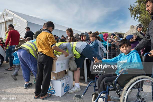 Volunteers serving breakfast for refugees in Greece