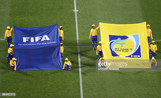 Volunteers show the FIFA flags before the FIFA Confederations Cup match between New Zealand and Spain at Royal Bafokeng Stadium on June 14 2009 in...