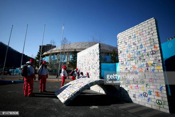 Volunteers sign the Truce Wall during a break in between flag raising ceremonies during previews ahead of the PyeongChang 2018 Winter Olympic Games...