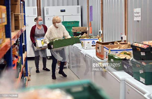 Volunteers sort food at Blackpool Food Bank in Blackpool, north west England, on March 9, 2021. - In Britain's most deprived areas, such as seaside...