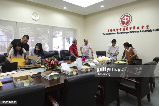 Volunteers sort postal ballot papers from overseas Malaysian citizens at The Kuala Lumpur and Selangor Chinese Assembly Hall in Kuala Lumpur Malaysia...
