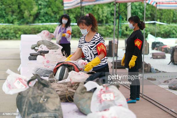 Volunteers sort the items collected from the sunken ship Oriental Star on Thursday June 11 2015 in Jianli China A tourist ship carrying approximately...
