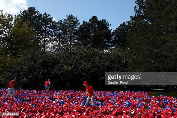 Volunteers sort through competitors' bags during the Challenge Triathlon Vichy on August 31 2014 in Vichy France