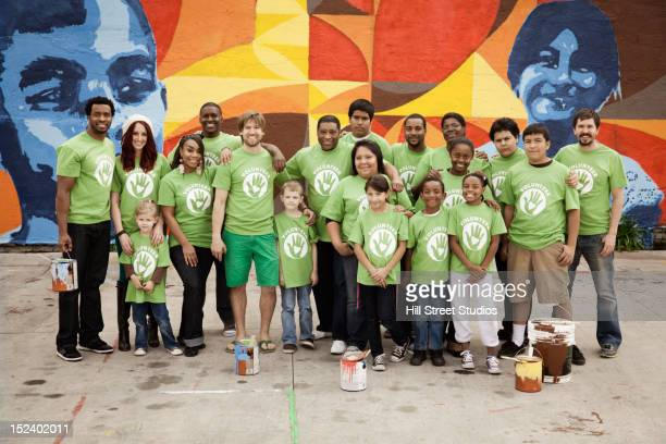 volunteers standing together - multiculturalism stock pictures, royalty-free photos & images