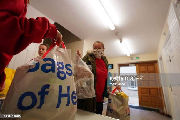 Volunteers take food parcels to be delivered on October 29, 2020 in London, England. Protest calling for free school meals in Whitehall 24th of...