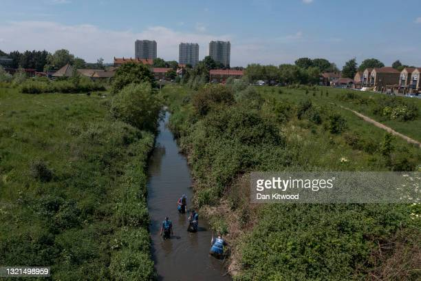 Volunteers take part in a river cleanup, organised by the waterway advocacy group Thames21, on June 03, 2021 in London, England. The event, in...