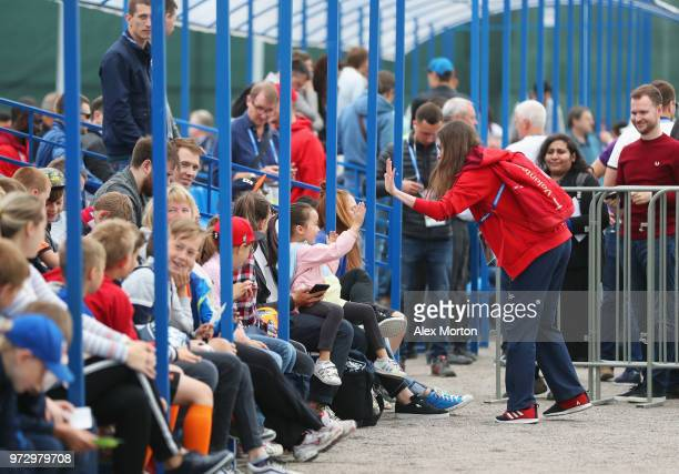 Volunteers take photographs of fans during the England media access at Spartak Zelenogorsk Stadium ahead of the FIFA World Cup 2018 on June 13 2018...
