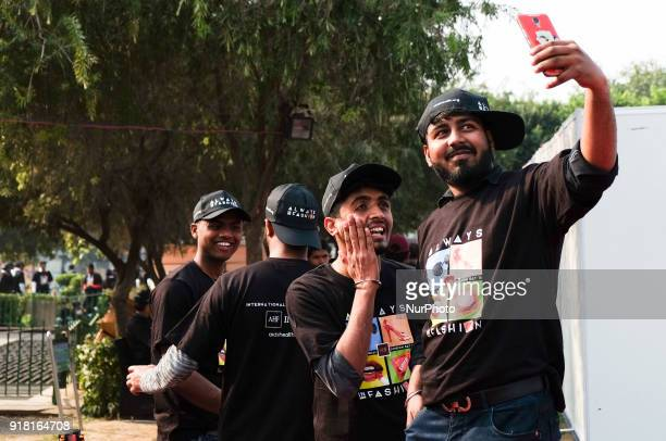 Volunteers take selfies during an event to mark International Condom Day in New Delhi on February 13, 2018.