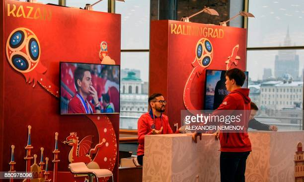 Volunteers talk to each other at the FIFA World Cup 2018 Final Draw media centre at the State Kremlin Palace in downtown Moscow on November 28 2017 /...
