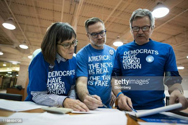 Volunteers tally votes during the first-in-the-nation Iowa caucus at the Southridge Mall in Des Moines, Iowa, U.S., on Monday, Feb. 3, 2020. Iowa...