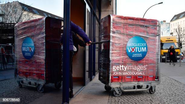 Volunteers transport ballots into the headquarters of Germany's social democratic SPD party in Berlin on March 3, 2018 before counting them as SPD...