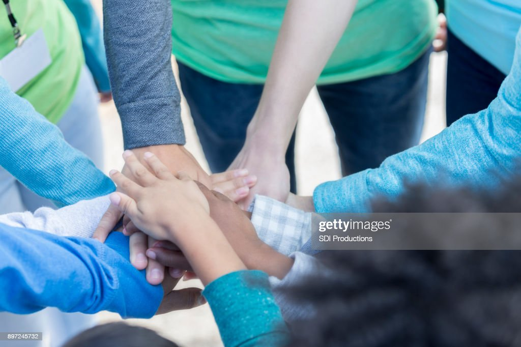 Volunteers unite during community charity event : Stock Photo