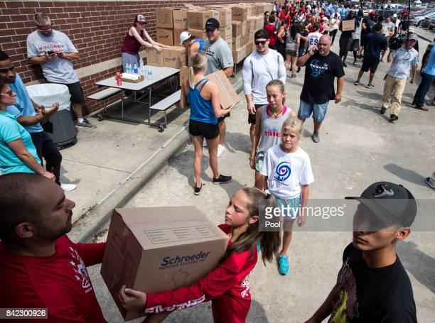 Volunteers unload a truck of relief supplies for people impacted by Hurricane Harvey on September 3 in Houston Texas JJ Watt's Hurricane Harvey...