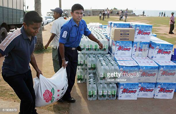 Volunteers unload bags of food as it arrives from around Sri Lanka and overseas on January 2 2005 in Comombo Sri Lanka UN Secretary General Kofi...