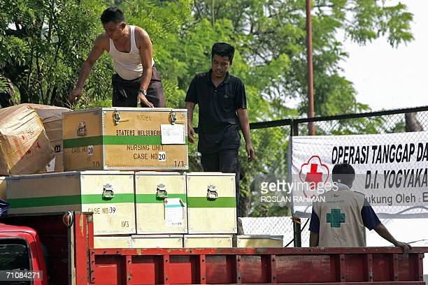 Volunteers unload medical aids from the last Tsunami supply donated by Norway at the Red Cross centre in Bantul Yogyakarta 31 May 2006 While the...