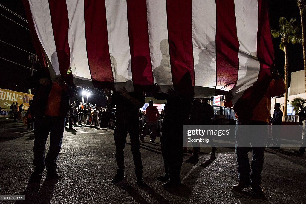 Volunteers unroll an American flag at a location prior to an event with Hillary Clinton, former Secretary of State and 2016 Democratic presidential candidate, during a campaign rally at the Laborers International Union in Las Vegas, Nevada, U.S., on Thursday, Feb. 18, 2016. Polling suggests Clinton is in danger of being overtaken by Sanders, a Vermont senator and self-described democratic socialist when the Nevada caucuses are held on February 20. Photographer: David Paul Morris/Bloomberg via Getty Images