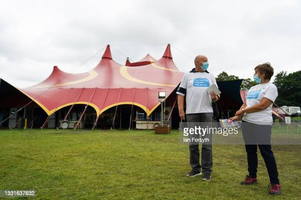 Volunteers wait to greet members of the public at a new 'Pop Up' vaccination centre in the Big Top of Circus Extreme in Shibden Park on July 31, 2021...