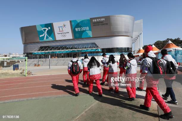 Volunteers walk outside of the Kwandong Hockey Centre prior to the Women's Ice Hockey Preliminary Round Group A game between Canada and Finland on...