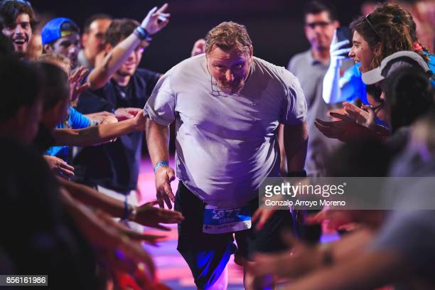 Volunteers welcome an athlete as he arrives to the finish line of the IRONMAN Barcelona on October 01 2017 in Calella Barcelona province Spain
