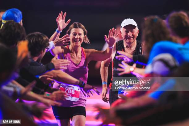 Volunteers welcome athletes as they arrive to the finish line of the IRONMAN Barcelona on October 01 2017 in Calella Barcelona province Spain
