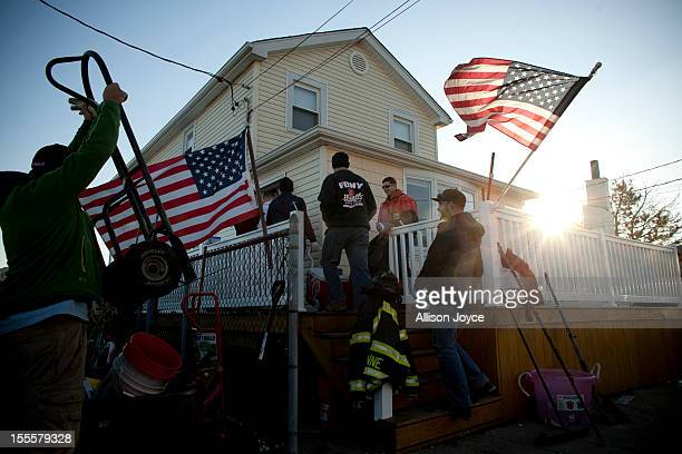 Volunteers who call themselves the Broad Channel Police Department walk into the house where they are staying November 5 2012 in the Broad Channel...