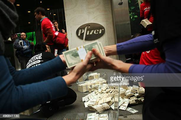 Volunteers with Doctors Without Borders dump $17 million in fake money outside of Pfizer's headquarters to protest high vaccine prices on November...