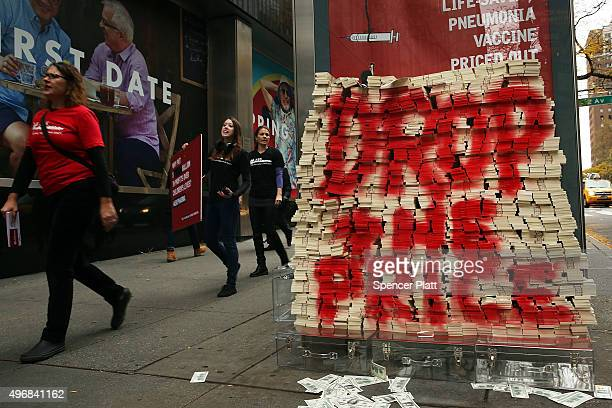 Volunteers with Doctors Without Borders dump $17 million in fake money outside of Pfizer's headquarters to protest high vaccine prices on November 12...
