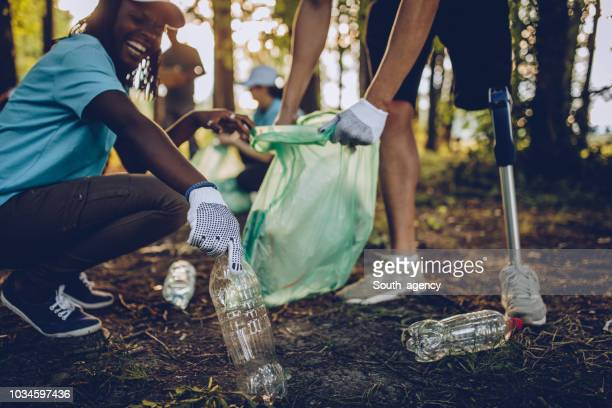 volunteers with garbage bags - disability collection stock pictures, royalty-free photos & images