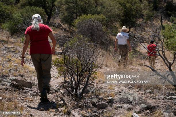 Volunteers with the Green ValleySahuarita Samaritans approach a water station near Nogales Arizona on July 15 2019 Volunteers of the Green...