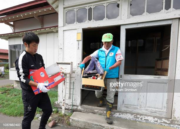 Volunteers work a week after the magnitude 67 earthquake on September 13 2018 in Atsuma Hokkaido Japan Concerns are rising about the health of the...